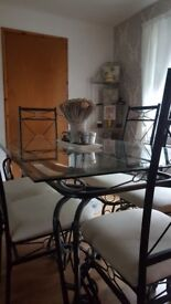 Glass table and 6chairs plus silver corner unit must uplift £130