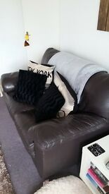 chocolate 2 seater sofa. In good condition . going cheap.