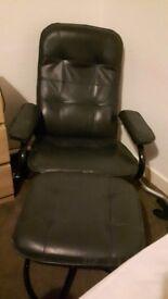 Dark green recliner with footstool