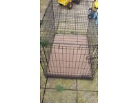 XL dog cage with cushioned tray bed