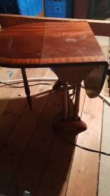 Small table with leaf each side