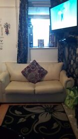 Cream leather bed settee