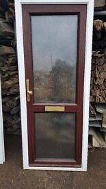 Upvc brown front door with white frame