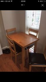 Extending wooden table & 4 chairs