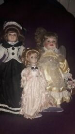 11 porcelain dollies mixed sizes all used need bit of TlC been in storage