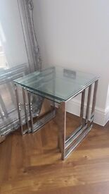 Beautiful glass and chrome nest of tables .