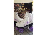 Rollerskates purple and white
