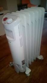 Freestanding electric oil heater