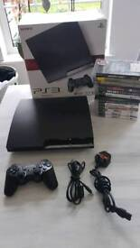 Ps3 120 GB console as new condition with 13 games including GTA 5.