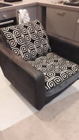 DFS single swivel charcoal chair, round chromed base, patterned base and back cushion