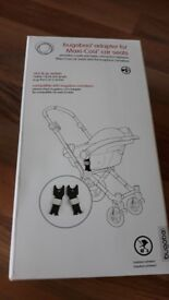 Brand new Bugaboo adapters for a maxi cosi car seat