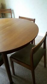 Nathan teak extendable dining table and 6 matching dining chairs