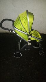 Lime green pram with car seat
