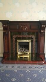 Housing units fireplace n living flame fire. Dark wood surround, tiled hearth.