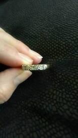 Aquamarine marine and diamond eternity ring