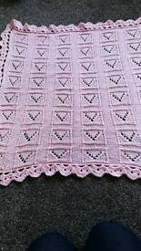 New pink knitted baby blanket