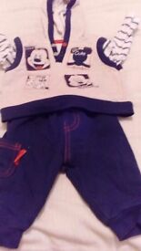 Hooded mickey mouse top and blue trousers