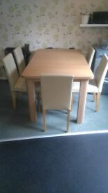 extending dining table and 5 chairs