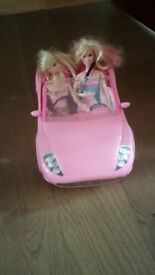 Barbie car and 2 dolls