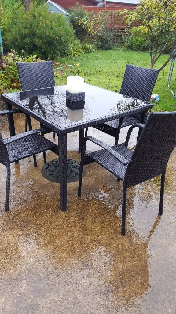 Rattan table and four chairs