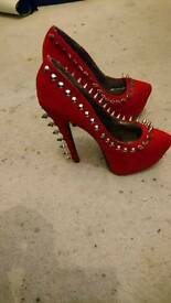 Red Spiked high heels