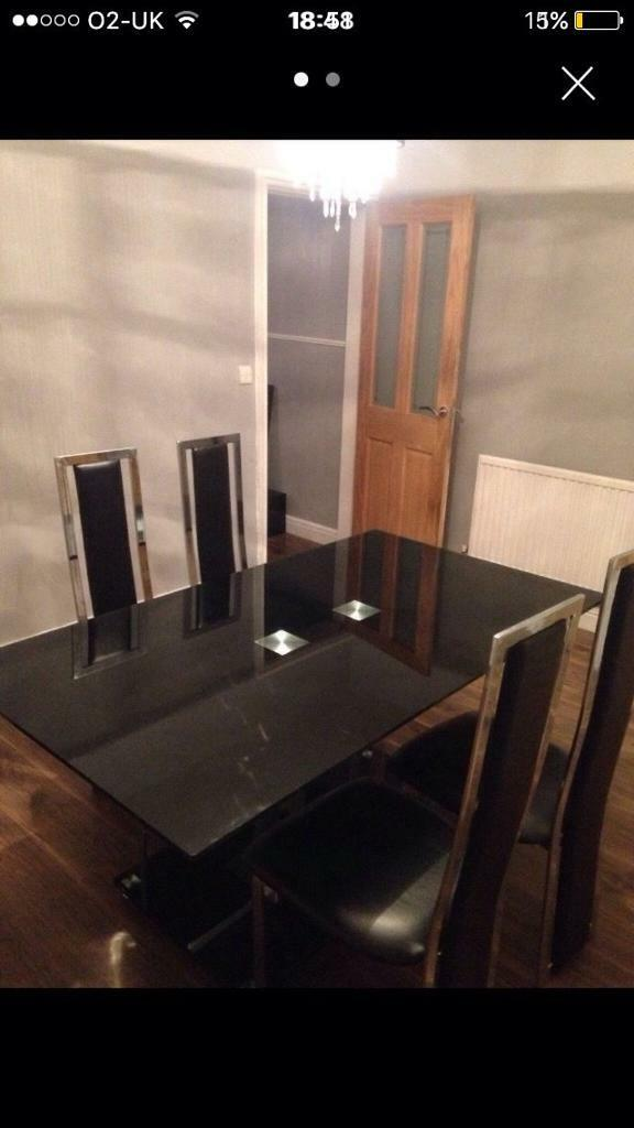 Black glass table four chairs