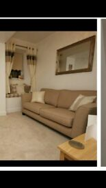 Brand new 4 seater cream sofa and matching footstool