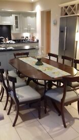 Solid mahogany table and 8 chairs.Table dates to 1840/1870.