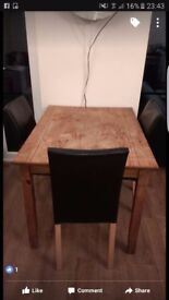 Oak dining table and 4 faux leather chairs