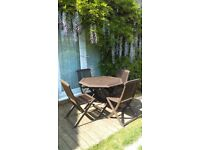 Garden table and four chairs , Teak and weatherproofed for summer.