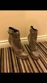 Grey high heeled boots