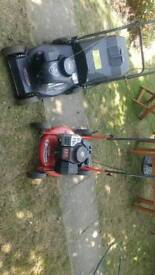 2 petrol lawn mowers