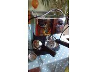 Brief Versatile Coffee & Milk Frothing Machine.