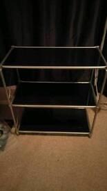 Black and silver glass shelf unit