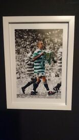 White framed photo of Henrik Larsson