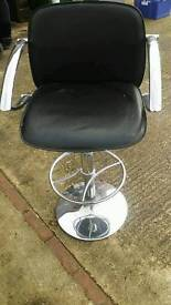 One black an chrome bar stool