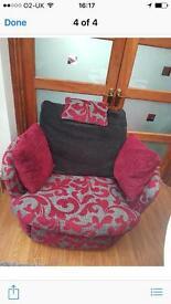 A dfs swivel recliner cuddle chair