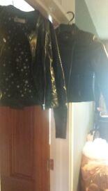 2 girls black jackets