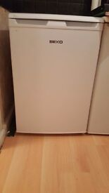 white Beko fridge, less than 2 year old, immaculate condition.
