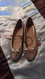 Brand new with tags gold shoes 6