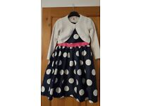 Navy and white spotted dress, size 6 - 7 years with white John Lewis Cardigan, size 6 years.