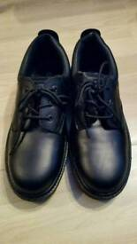 Steel toe capped shoes for sale.