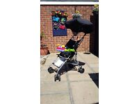 Folding buggy complete with parasol rain cover and activity toy