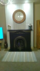 Fire and fireplace - Victorian black and chrome cast iron with gas fire.