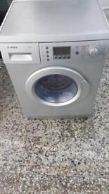 Bosch washer dryer 7kg 1200rpm 4 month warranty free delivery and installation