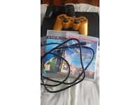 Super slim sony playstation 3/3games/2controllers