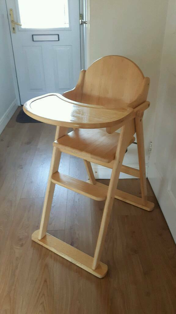 Solid wood high chair with flip over tray