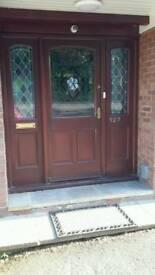 Wooden front door glazed