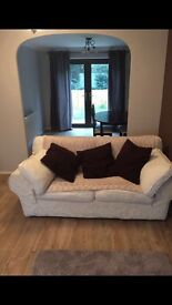 Two cream sofas - 2 seater and 4 seater