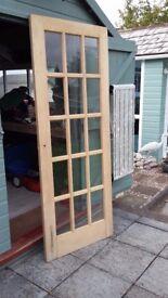 Internal glass panel door